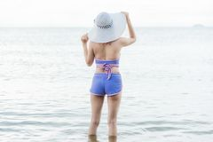 Outdoor summer portrait of young beautiful woman Helmeted looking to sea royalty free stock images