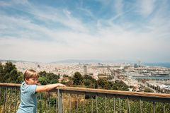 Outdoor summer portrait of young kid boy. Cute little boy tourist admiring Barcelona city from Montjuic hill, travel with children royalty free stock images