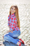 Outdoor summer portrait of young pretty cute blonde girl. Beautiful woman posing in spring. Royalty Free Stock Image