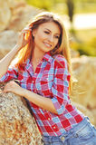 Outdoor summer portrait of young pretty cute blonde girl. Beautiful woman posing in spring. stock image