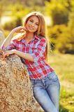 Outdoor summer portrait of young pretty cute blonde girl. Beautiful woman posing in spring. Royalty Free Stock Images