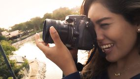 Outdoor summer smiling lifestyle portrait of pretty young woman having fun in the city of Lima taking pictures stock images