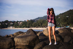 Outdoor summer stylish portrait of beautiful elegant woman with perfect fit body and long legs walking along on the Royalty Free Stock Images