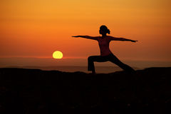 Outdoor sunrise yoga girl Stock Photos