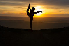 Outdoor sunrise yoga girl Stock Photography