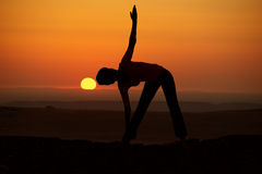 Outdoor sunrise yoga girl Royalty Free Stock Photos