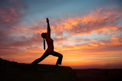 Outdoor sunrise yoga girl Royalty Free Stock Images