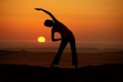 Outdoor sunrise yoga girl Royalty Free Stock Image