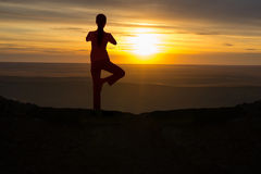Outdoor sunrise yoga girl Royalty Free Stock Images