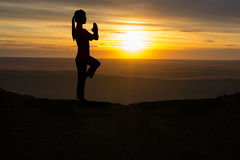 Outdoor sunrise yoga girl Royalty Free Stock Photo