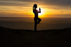 Outdoor sunrise yoga girl Stock Image