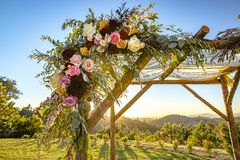 Jewish traditions wedding ceremony. Wedding canopy chuppah or huppah close up on the flowers. Outdoor sunset view of a Jewish traditions wedding ceremony Royalty Free Stock Photography