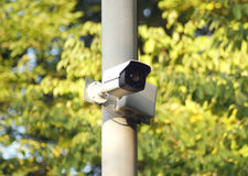 Outdoor surveillance camera on a pole in the park stock images