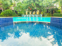 Outdoor swimmimg pool with waterfall Stock Image