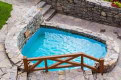 Outdoor swimming pool. With blue stone transparent water Stock Image