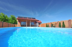 Outdoor swimming pool Stock Photos