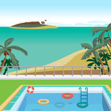 Outdoor swimming pool on the beach in the tropics Royalty Free Stock Photography