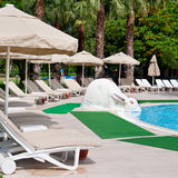 Outdoor swimming pool. And beautiful palm trees Royalty Free Stock Image