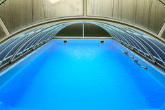 Outdoor swimming pool with cover Royalty Free Stock Photos