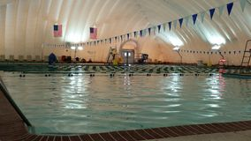 Outdoor swimming pool covered for winter by inflated bubble Royalty Free Stock Images