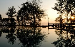 Outdoor swimming pool at dusk Stock Photo