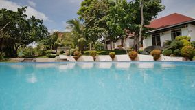 Outdoor swimming pool in an exotic country. Recreation near the ocean. Philippines. Outdoor swimming pool in an exotic country. Recreation near the ocean stock footage