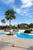 Outdoor swimming pool facilities of a big hotel complex after season. Outdoor swimming pool facilities of a big hotel complex at the beach of greece, directly Royalty Free Stock Photos