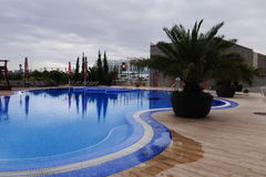 Outdoor swimming pool in the hotel Stock Images