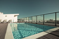 Outdoor swimming pool at the House roof Royalty Free Stock Photography