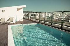 Outdoor swimming pool at a house roof Royalty Free Stock Photos
