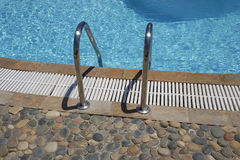 Outdoor swimming pool ladder. Stock Photography