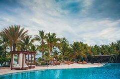 Outdoor Swimming pool of luxury hotel resort near Royalty Free Stock Photography