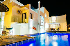 Outdoor swimming pool at night Stock Image