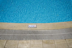 Outdoor swimming pool with no diving sign. Stock Image