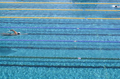 Outdoor swimming pool with  swimmers Royalty Free Stock Photography