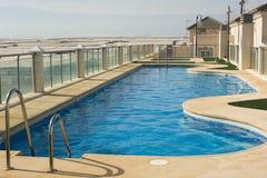 Outdoor swimming pool Stock Photos