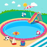 Outdoor Swimming Pool with Toys. Summer Time Stock Photo