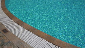 Outdoor swimming pool with turquoise water. stock video footage