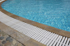 Outdoor swimming pool with turquoise water. Royalty Free Stock Photos