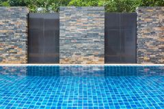 Outdoor swimming pool wall background. stock images