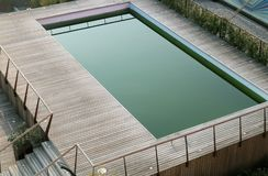 Outdoor swimming pool with wooden floor Stock Photos
