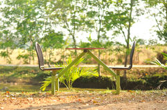 Outdoor table with chairs in garden Stock Images