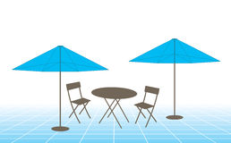 Outdoor table, chairs and umbrellas Stock Image