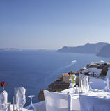 Outdoor table facing Aegean Sea Royalty Free Stock Image