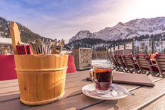 Outdoor table restaurant with cutlery and hot drink Royalty Free Stock Photo