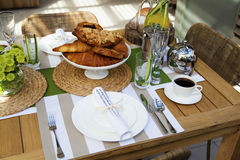 Outdoor table setting for two. Stylish outdoor table setting for two Stock Photos