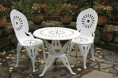 Outdoor table and two chairs. Ornate table and two chairs in outdoor entertaining area Stock Photos