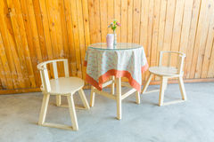 Outdoor table and two chairs near the wood wall at coffee shop, Stock Photos