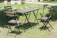 Outdoor tables and chairs set up on the green lawn Stock Photos