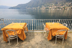 Outdoor tables on Lake Como Stock Photography